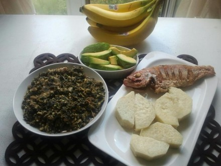 Spinach stew ( palava sauce ) ,boiled yam & avocado pear